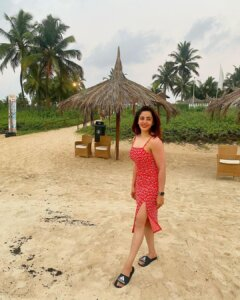 Neha Pendse in red sleeve less dress