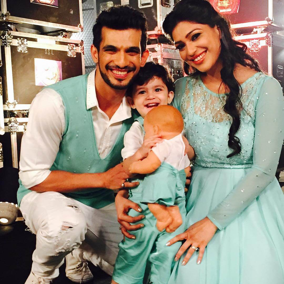 Photo of neha swami with her husband and child