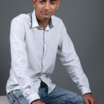 Lyon Diab in jeans and shirt