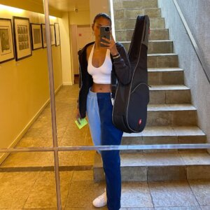 Sela Vave in Track Pants With Guiter